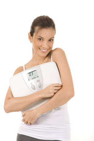 Woman on white background holding a scale