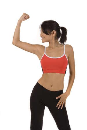Young woman on white background in fitness pose.