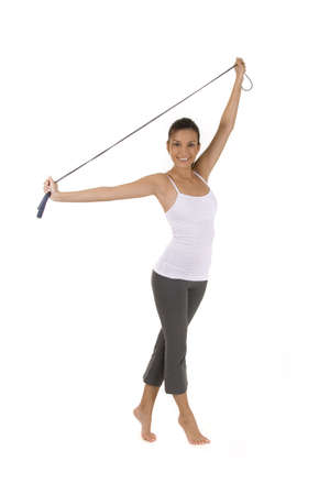 Woman on white holding a jump rope. Stock Photo - 5255433