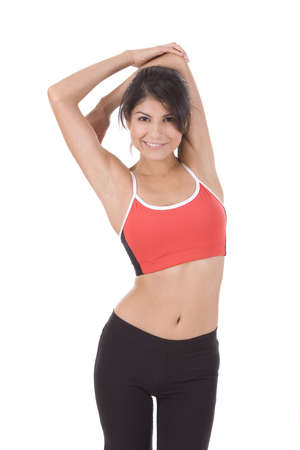 tricep: Young woman on white background stretching tricep.