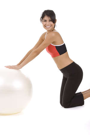 Woman on white on a fitness ball  photo