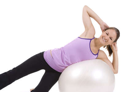 Young woman on white background in a fitness pose  photo