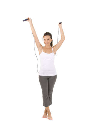Woman on white holding a jump rope. Stock Photo - 5262983
