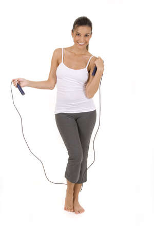 Woman on white holding a jump rope. Stock Photo - 5282228