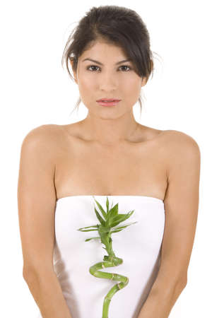 Young woman on white holding green bamboo. Stock Photo - 5282196