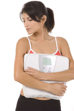 Woman on white background holding a scale Stock Photo - 5282233