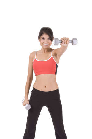 Woman on white holding silver dumbbells to camera. photo