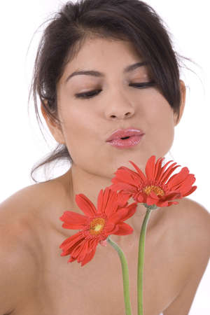 Young woman on a white background with red flower. photo
