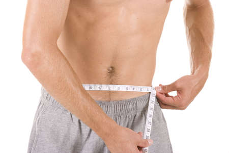 slim tummy: Man on white background with measuring tape.