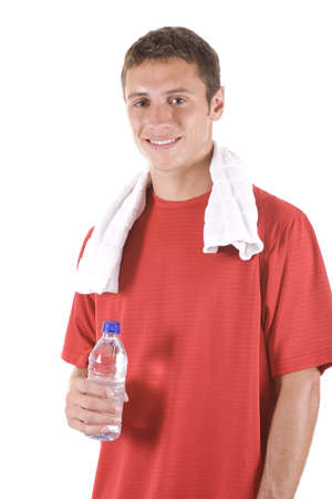 Young man on white with a water bottle. photo