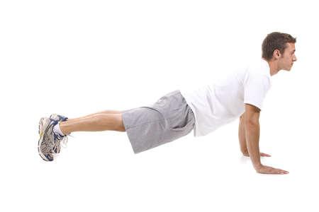 push: Man on white background doing push ups.