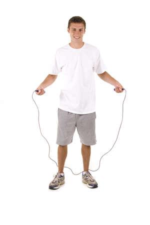 L'uomo su bianco in possesso di un corda per saltare. Archivio Fotografico - 5558751