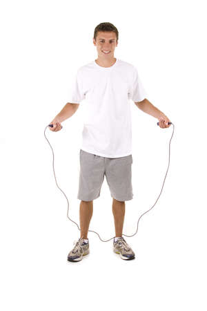 Man on white holding a jump rope.