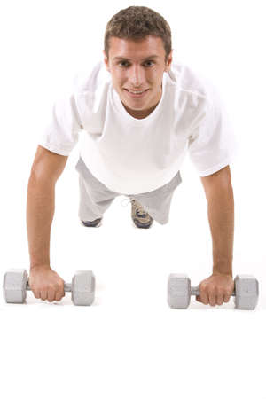 Man on a white background in a fitness pose. photo