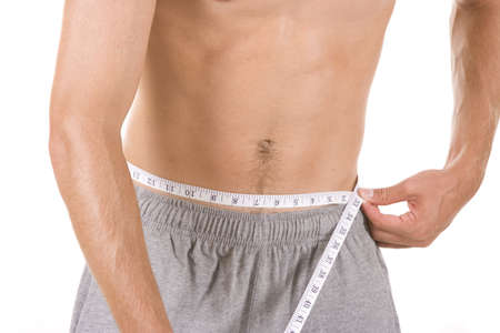 weight loss man: Man on white background with measuring tape.