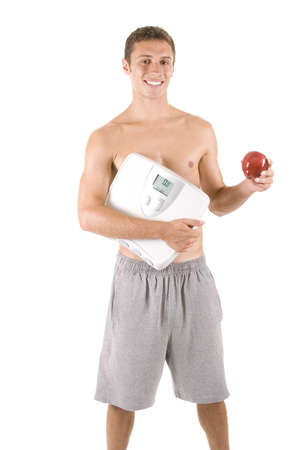 Man on white background with a scale and apple. photo
