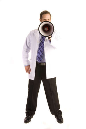 Young doctor on white shouting into a megaphone. Stock Photo - 5856416