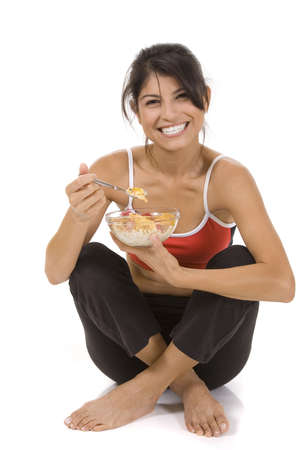Young woman on white background with a bowl of cereal Stock Photo - 5856407
