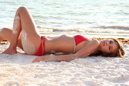 Beautiful woman on the beach iin a bikini swimsuit. Stock Photo - 5882817