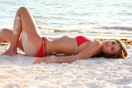 Beautiful woman on the beach iin a bikini swimsuit. Stock Photo - 5882817