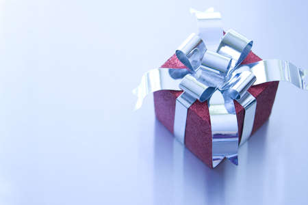 Beautiful Christmas gifts on a silver background photo