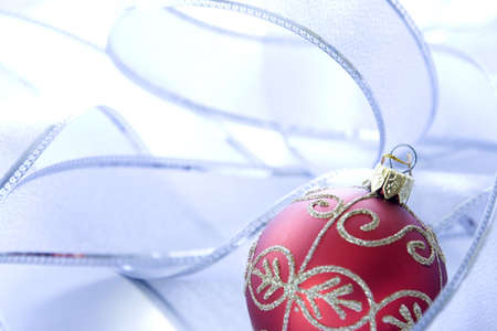 silver ribbon: Red Christmas ornament with a silver ribbon.