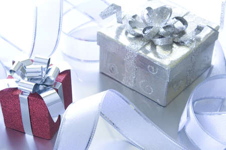 Beautiful Christmas gifts on a silver background Stock Photo - 5910081