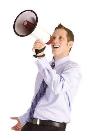 Young businessman on white shouting into a megaphone.