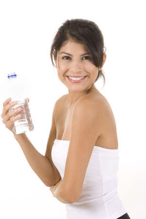 Woman in fitness pose holding water bottle. photo
