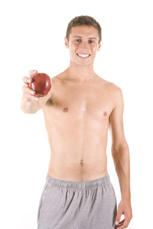 Young man on white eating an apple. photo