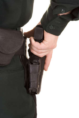 Close of of policemans hand on his gun. Stock Photo