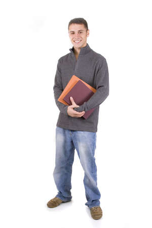 Young male student holding books in casual clothes. Stock Photo