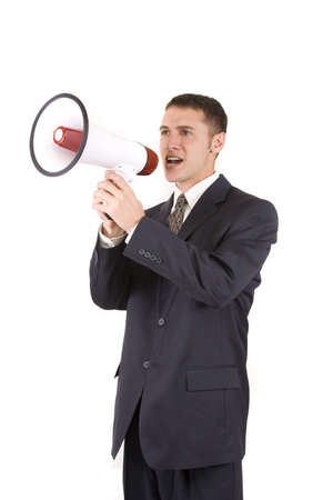 Young attractive businessman shouting into a megaphone Stock Photo - 6187693