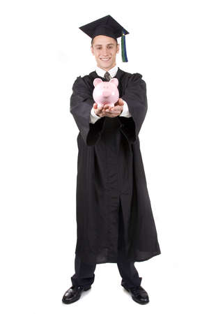 college fund savings: Young graduate in cap and gown holding a piggy bank. Stock Photo