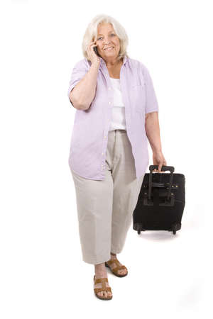 Beautiful mature woman on white with a suitcase photo