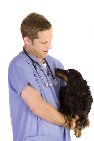 Veterinarian on white holding a black dog. Banco de Imagens - 6189253