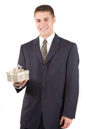 Happy businessman with a gift for holidays photo