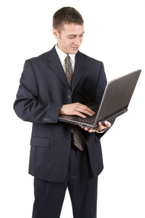 Young businessman using a laptop on white background