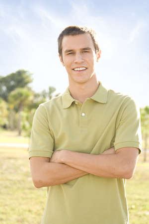 Young attractive casual man outside smiling into camera Stock Photo - 6189270