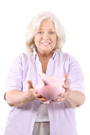 Beautiful mature woman with a piggy bank on white. Stock Photo - 6226508