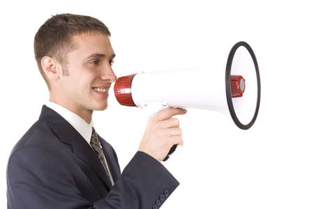 Young attractive businessman shouting into a megaphone. Stock Photo