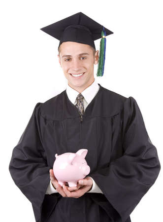 Young graduate in cap and gown holding a piggy bank. Banco de Imagens - 6226510