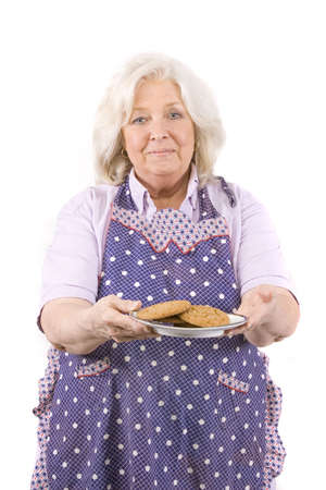 Beautiful mature woman holding a plate of cookies