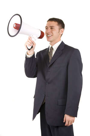 Young attractive businessman shouting into a megaphone Stock Photo - 6250044