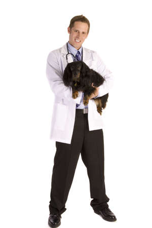 minature: Veterinarian on white holding a black dog