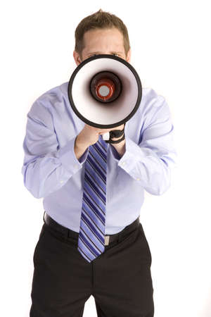 Young attractive businessman shouting into a megaphone. Stock Photo - 6249980