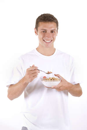 Man on a white background eating cereal.
