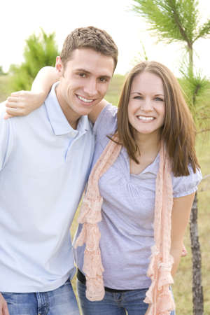 Casual man and woman outside posing together. photo