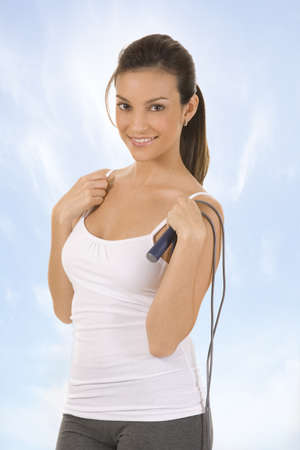young and healthy woman holding a jump rope. photo