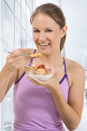 Young beautiful woman with a bowl of cereal photo